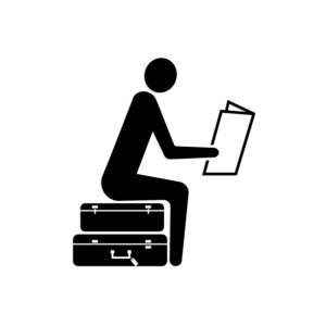 icon of a stick figure person sitting on two suitcases reading paper